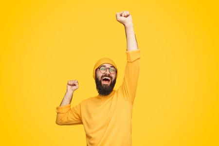 Foto de Excited bright man with fist up - Imagen libre de derechos