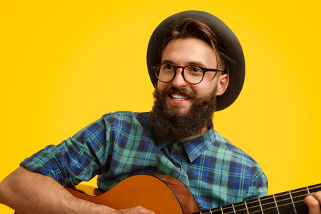 Photo for Hipster with guitar looking away - Royalty Free Image