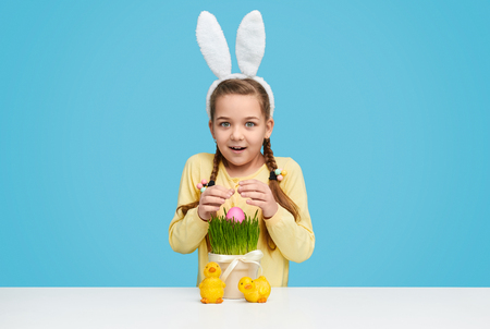 Photo for Cute girl finding egg in grass - Royalty Free Image