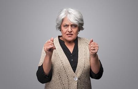 Foto de Angry senior female looking at camera - Imagen libre de derechos