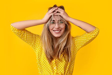 Photo for Excited young woman rumpling hair - Royalty Free Image