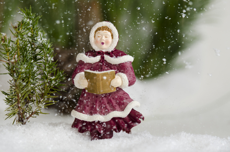 Photo for Caroler sing in the snow fall - Royalty Free Image
