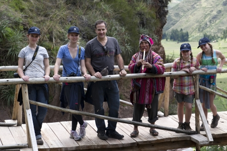 Man with his family on a footbridge at Archaeological Park of Pisac, Pisac, Sacred Valley, Cusco Region, Peru