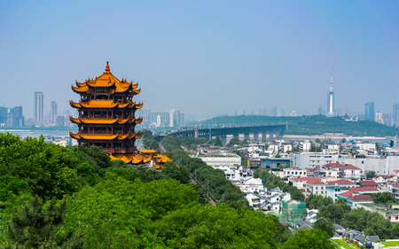 Foto de Yellow crane tower and Wuhan Yangtze Great Bridge scenic view in Wuhan Hubei China - Imagen libre de derechos