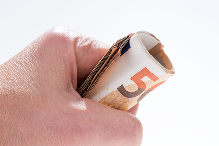 Foto für A roll of fifty euro banknotes in the hand - Lizenzfreies Bild
