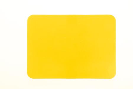 Foto de Yellow card isolated on white for sport concept - Imagen libre de derechos