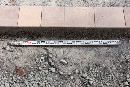 Photo for New colorful paving stones and meter measure. Start of construction work - Royalty Free Image