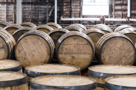 Photo for Bourbon Barrel Storage Room with barrels standing and rolling - Royalty Free Image