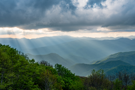 Photo for Sun Rays Fall From Clouds Over Smokies - Royalty Free Image