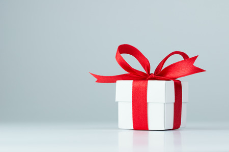 Photo for Gift box with red ribbon on white background - Royalty Free Image