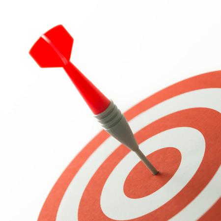 Foto de Meet target concept using dart pinned at the bullseye - Imagen libre de derechos