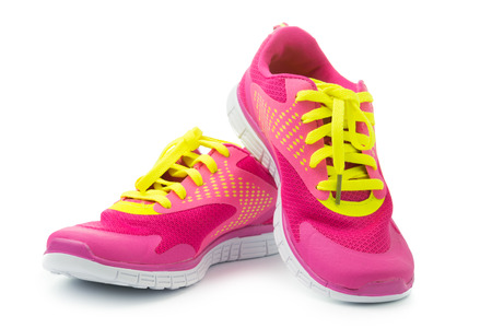 Photo pour Pair of pink sport shoes on white background - image libre de droit