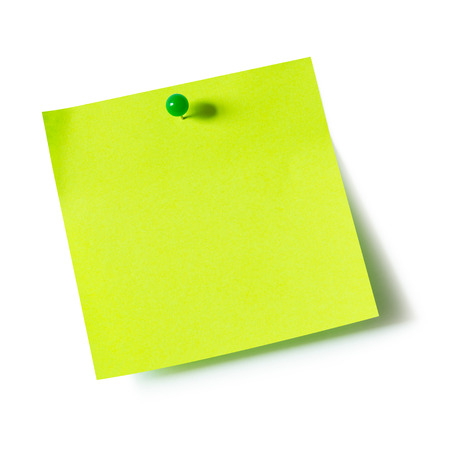 Foto de Green paper note pad attached with push pin on white background - Imagen libre de derechos