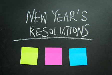 Photo pour The word New Year's resolution written on the blackboard with blank notes - image libre de droit