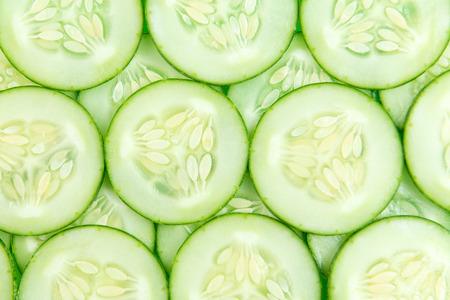 Photo pour Close up of fresh cucumber slices background - image libre de droit