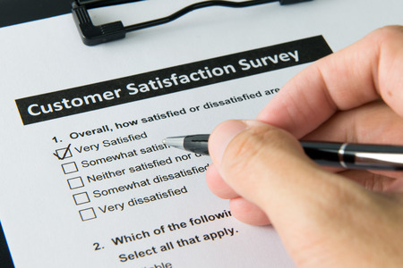 Photo for Filling customer satisfactory survey form with pen - Royalty Free Image