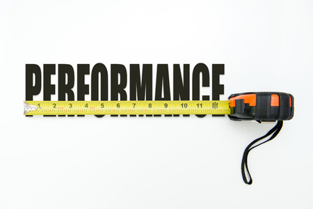 Foto per Measuring tape over the word performance on white background - Immagine Royalty Free