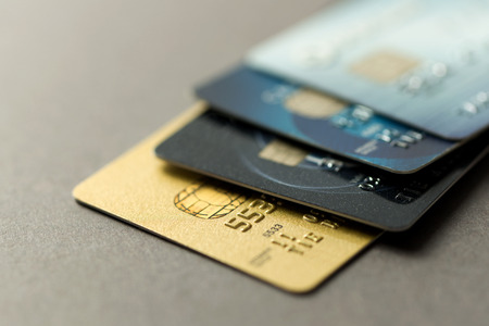 Photo pour Close up of credit cards over grey background - image libre de droit