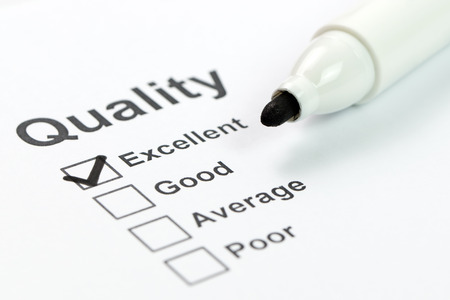 Foto de Close up of quality control form and marker - Imagen libre de derechos