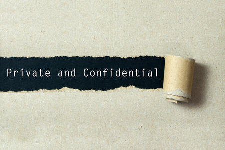 Photo pour Private and confidential written on torn paper black background - image libre de droit