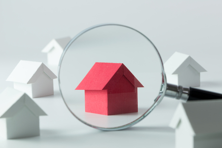 Foto de House searching concept with a magnifying glass - Imagen libre de derechos
