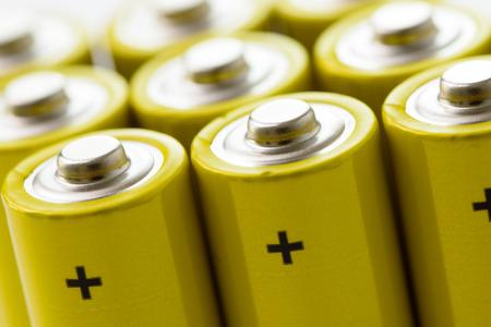 Photo pour Group of yellow alkaline batteries forming background - image libre de droit