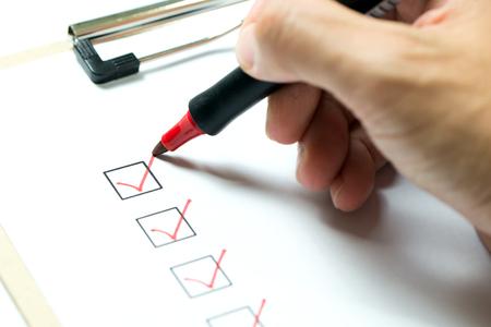 Foto de Checklist marked red with a red pen - Imagen libre de derechos