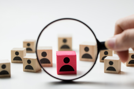 Photo for Searching for talent or looking for employee concept using magnifying glass and wooden cube with people icon - Royalty Free Image