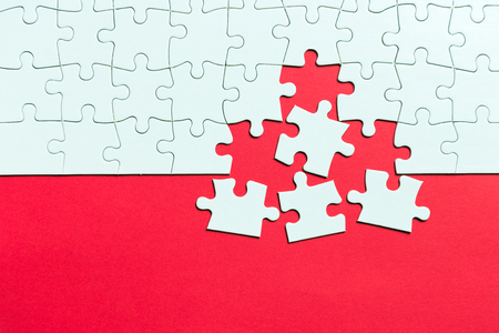 Photo pour Red  made from white jigsaw puzzle pieces and place for your content - image libre de droit