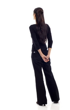 Photo pour Asian business woman from the back - looking at something isolated over white background - image libre de droit