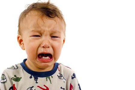 Foto de Unhappy, Crying Baby Boy a lot of Copyspace - Isolated over a white background - Imagen libre de derechos