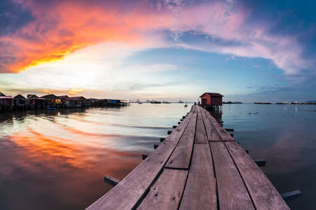 Photo for Wooden bridge Clan Tan Jetty view during sunrise in George Town, Penang - Royalty Free Image