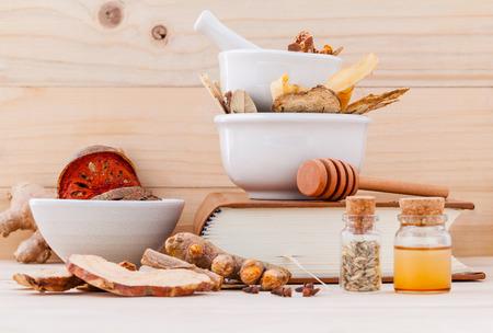 Foto de Alternative Medicinal , Chinese herbal medicine  for healthy recipe with dry herbs  and mortar on wooden background. - Imagen libre de derechos