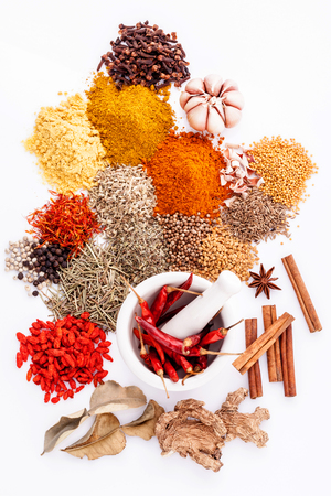 Assorted of spices black pepper ,white pepper,fenugreek,cumin ,bay leaf,cinnamon,thyme,matrimony vine(chinese wolfberry),safflower,rosemary and fennel seeds with white mortar isolated on white background.