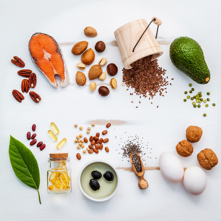 Photo for Selection food sources of omega 3 . Super food high omega 3 and unsaturated fats for healthy food. Almond ,pecan ,hazelnuts,walnuts ,olive oils ,fish oils ,salmon ,flax seeds ,chia ,eggs and avocado . - Royalty Free Image
