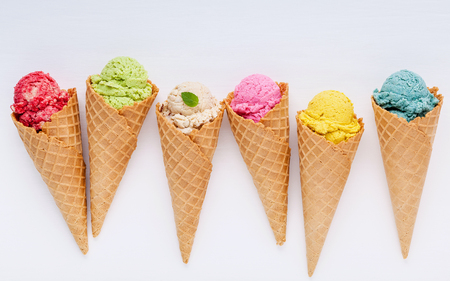 Photo for Various of ice cream flavor in cones blueberry ,strawberry ,pistachio ,almond ,orange and cherry setup on white wooden background . Summer and Sweet menu concept. - Royalty Free Image