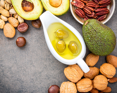 Photo for Selection food sources of omega 3 and unsaturated fats. Superfood high vitamin e and dietary fiber for healthy food. Almond ,pecan,hazelnuts,walnuts,olive oil,fish oil and salmon on stone background. - Royalty Free Image