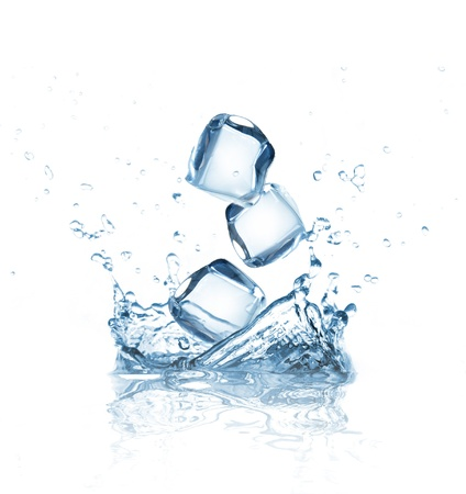 Ice cubes splashing into water over white