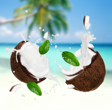 Photo for Coconut with milk splash on the beach - Royalty Free Image