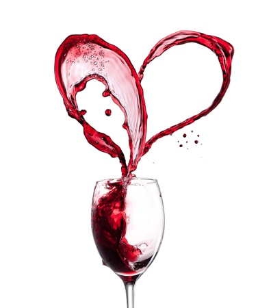 Photo pour Red wine heart over white background - image libre de droit