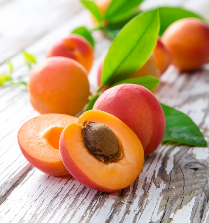 Photo for Fresh apricots on wooden table - Royalty Free Image