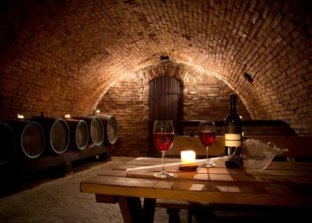Photo pour Wine cellar with wine bottle and glasses - image libre de droit
