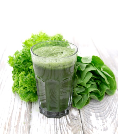 Photo for Healthy green vegetable juice on wooden table - Royalty Free Image