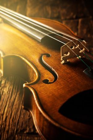 violin in vintage style on wood