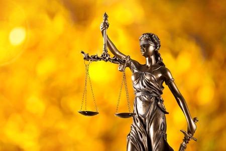 Foto de Themis in spotlight - concept of justice. - Imagen libre de derechos