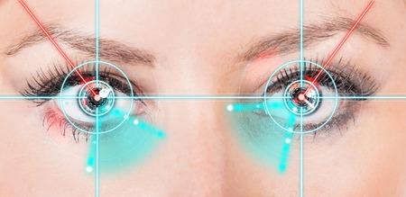 Foto de Close-up woman eyes with laser medicine, technology concept. - Imagen libre de derechos