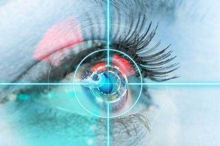 Foto de Close-up woman eye with laser medicine, technology concept. - Imagen libre de derechos