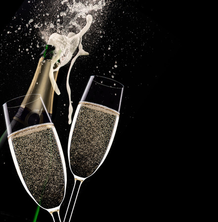 Foto de Champagne flutes on black background, celebration theme. - Imagen libre de derechos