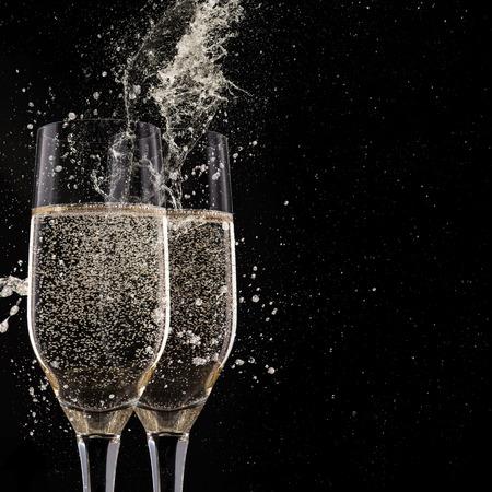 Photo for Champagne flutes on black background, celebration theme. - Royalty Free Image