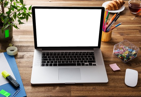 Photo pour Workplace with notebook, office supplies and wooden desk. - image libre de droit